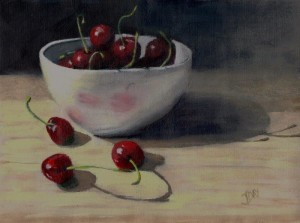 Still life with cherries in white bowl